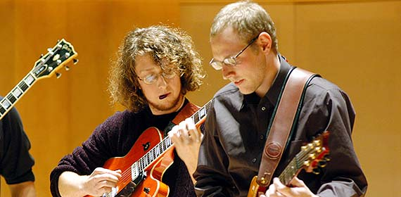 Guitarists playing in the Weber Music Hall.
