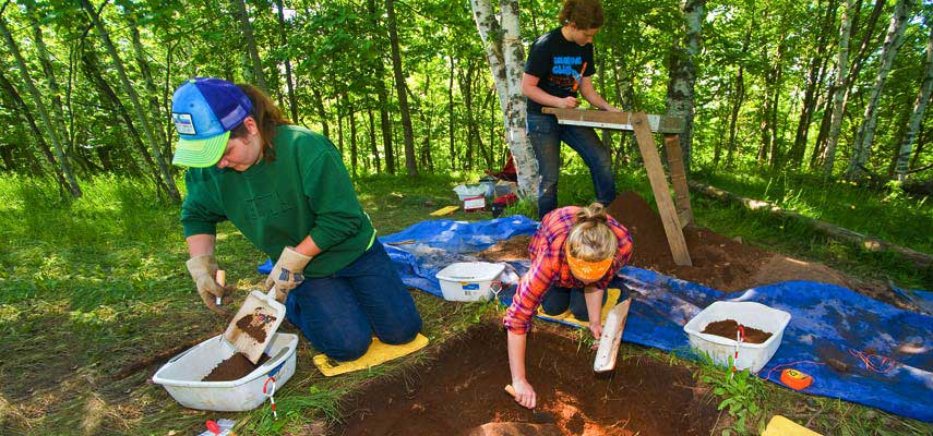 Students dig and screen for artifacts as part of a Field Research in Archaeology class taught on campus and at a site along Skyline Parkway in Duluth.