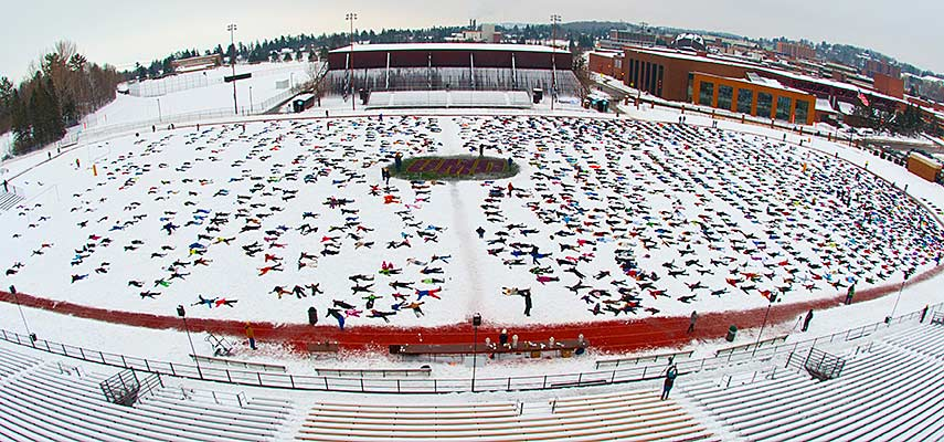 Almost 2,000 people made snow angel figures in the snow on UMD's Griggs Field as a fundraiser for those in Ethiopia affected by climate change.