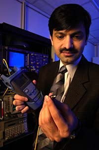 Faculty member with an elctronic sensor.