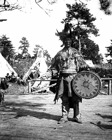 Chippewa medicine man singer with ceremonial turtle clan drum.