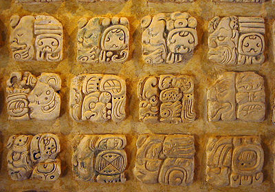 Maya glyphs in stucco at the Museo de sitio in Palenque, Mexico.