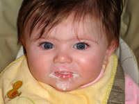 Claire Kathleen Roufs eating first food at 5 months.