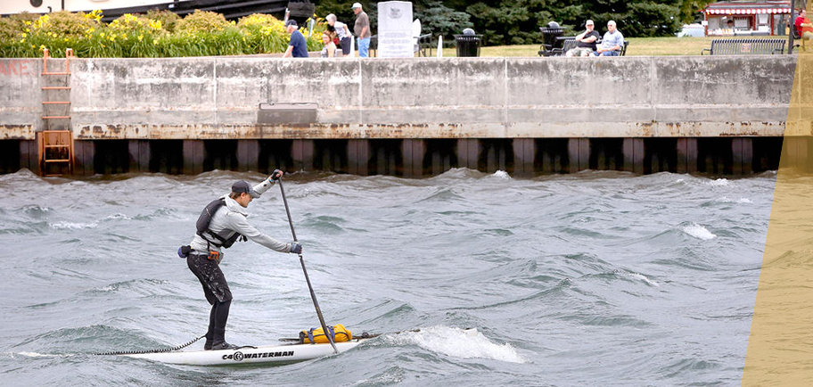 UMD student Jared Munch paddles Lake Superior near Canal Park, photo by Bob King, Duluth News Tribune