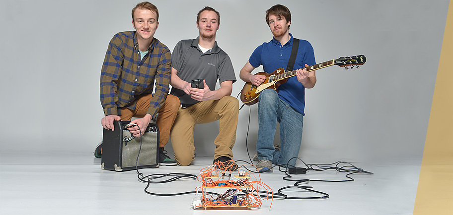 UMD seniors Nick Robillard, Charlie Farrell, and Miles Pearson with prototype of their foot pedal app