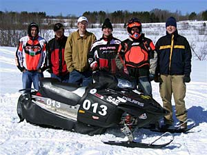 Students with snowmobile.